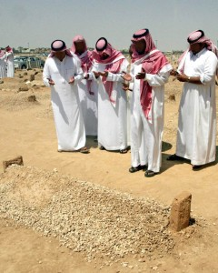 Saudi men prays at grave of late King Fahd after Friday prayer in Riyadh